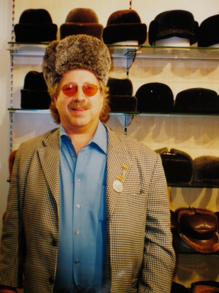 Jon Hammond Tries on Russian Fur Hat or ushanka (уша́нка) in GUM Department Store Moscow Russia while there to play concerts in Trio with Igor Butman